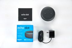 Amazon Echo dot. MONTREAL, CANADA - DECEMBER 17, 2018: Amazon Echo Dot unboxed over white background. Amazon Echo and Echo Dot are a brand of smart speakers royalty free stock photo