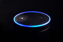 Amazon Echo voice recognition. System, selective focus and dark backdrop for impact of light ring Stock Photos