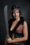 Amazon girl. With the machete royalty free stock photography
