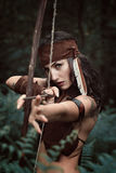 Amazon huntress aiming with bow Royalty Free Stock Photo