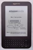 Amazon inflama o E-Leitor Foto de Stock