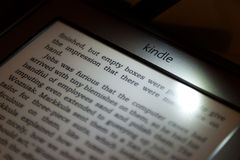 Amazon Kindle. A close up of the new Amazon Kindle.  Lit with the built in light from the case Stock Photos