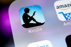 Amazon Kindle application icon on Apple iPhone X screen close-up. Amazon Kindle app icon. Amazon kindle application. Social media. Sankt-Petersburg, Russia royalty free stock images