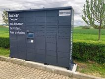 Amazon locker located at a petrol station in Ostfildern, Germany stock images