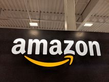 Amazon logo on black shiny wall in Honolulu Best Buy store stock images