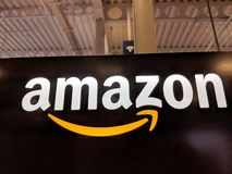 Amazon logo on black shiny wall in Honolulu Best Buy store. Honolulu - May 29, 2018: Amazon logo on black shiny wall in Honolulu Best Buy store. Amazon is an stock photos
