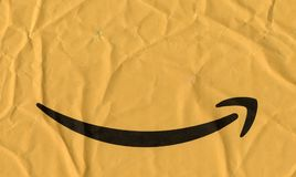 Amazon logo on a packet. SEATTLE, USA - CIRCA MAY 2018: Amazon arrow logo on a packet royalty free stock images
