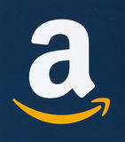 Amazon logo printed on paper. MONTREAL, CANADA - FEBRUARY 28, 2017: Amazon logo printed on a blue paper. Amazon is an American electronic commerce and cloud Stock Image