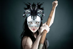 Amazon with mask and spear Stock Photos