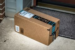 Amazon Prime brown box delivery. Lancaster, PA, USA - December 15, 2017: Amazon Prime brown box package delivered at a residential home front door stock photo