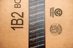 Amazon Prime logotype printed on cardboard box security scotch t Stock Images