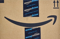 Amazon Prime shipping box. MONTREAL, CANADA - MARCH 28, 2017: Amazon Prime shipping box with branded tape on it. Amazon is an American electronic commerce and stock photo