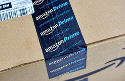 Amazon Prime shipping box. MONTREAL, CANADA - MARCH 28, 2017: Amazon Prime shipping box with branded tape on it. Amazon is an American electronic commerce and royalty free stock photography
