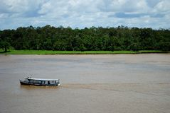 Amazon river. Boat at Amazon River. Urucara city,  Amazon Estate, Brazil Royalty Free Stock Image