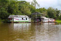 Amazon river houses in Amazonas, Brazil Stock Photos