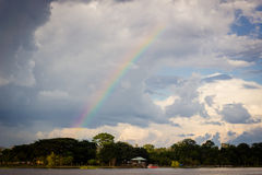 Amazon river jungle rainbow and clouds Stock Photo
