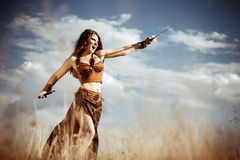 Amazon with a sword. Against the sky Stock Photography
