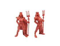 Amazon toy warriors. Isolated red plastic toy amazon warriors posing with weapons Royalty Free Stock Photos
