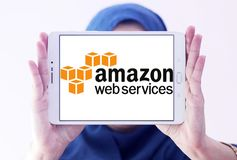 Amazon Web Services ,AWS, logo. Logo of Amazon Web Services ,AWS, on samsung tablet holded by arab muslim woman. Amazon Web Services provides on-demand cloud stock image