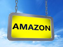 Amazon on billboard. Amazon on yellow light box billboard on blue sky background Stock Photos