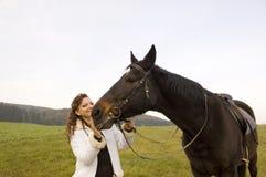 Amazona y caballo. Imagen de archivo libre de regalías