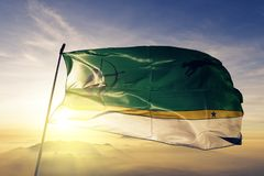 Amazonas Department of Colombia flag textile cloth fabric waving on the top sunrise mist fog. Beautiful royalty free stock photography