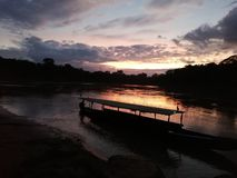 Amazonas. Peru, canu, canoe, afternoon, sunset stock photos