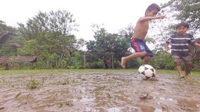 Amazonian Indigenous Children Playing Soccer In The Rain. In Ecuador stock video