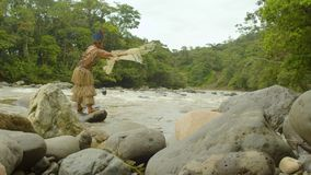 Amazonian Indigenous Man Meditating At The Edge Of A River. In Ecuador stock video footage