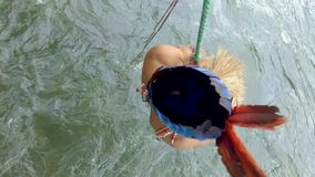 Amazonian Indigenous Man Swinging In A Rope Over The River. In Ecuador stock footage