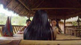Amazonian indigenous people drinking chicha. Amazonian indigenous people drinking fermented yucca beverage chicha in Ecuador stock footage