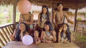 Amazonian Indigenous Playing And Releasing Colorful Balloons. In Ecuador stock video