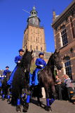 Amazons riding horse. Amazons dressed in blue dresses riding on the back of a horse. Taken during the bokbier festival in the dutch city zutphen 10-10-2010 Stock Images