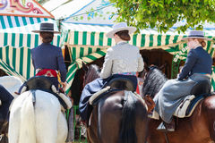 Amazons wearing traditional Andalusian uniforms at the April's Fair of Seville. Royalty Free Stock Photo