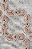 Ambachtborduurwerk door bruine en beige draden stock afbeeldingen