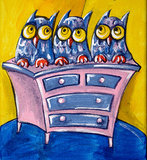THREE OWLS ON A CHEST OF DRAWERS Stock Photo