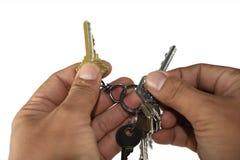 Ambas manos que seleccionan llaves Foto de archivo libre de regalías