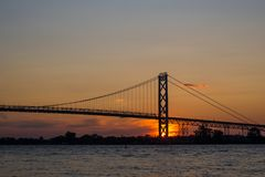 Ambassador Bridge connecting Windsor, Ontario to Detroit Michiga. View of Ambassador Bridge connecting Windsor, Ontario to Detroit Michigan at sunset time Stock Photos