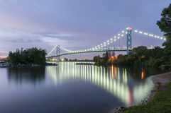 Ambassador bridge Windsor ontario. Ambassador bridge linking Windsor canada and Detroit usa at dusk Stock Photography