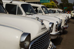 Ambassador Taxis, Hyderabad. HYDERABAD, ANDHRA PRADESH, INDIA - JANUARY 8: A row of white Ambassador cars, used as taxis, parked outside the main railway station Stock Photography