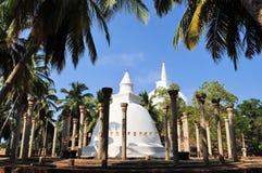 Ambasthala Stupa and Mahaseya Dagoba, Sri Lanka. Circle of ancient pillars and white washed Ambasthala stupa, overtowered by hilltop Mahaseya Dagoba, Sri Lanka Stock Photo