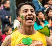 Ambato, Ecuador / Feb 15, 2015 - Man in costume dances at Carnaval. Parade stock photography