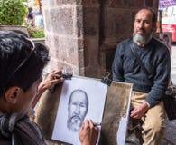 Ambato, Ecuador / Feb 15, 2015 - Street artist draws portrait. Of man stock photography