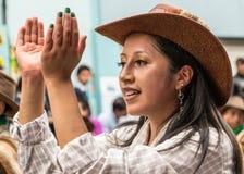 Ambato, Ecuador / Feb 15, 2015 - Woman in costume dances at Carnaval. Parade stock images