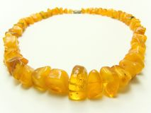Amber. Good-looking beautiful beads overflowing gold of eternity Stock Photos