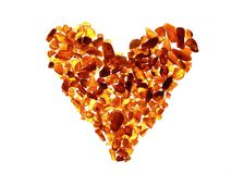 Amber. Heart with amber pieces - warm colours stock images