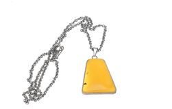 Amber. Women's jewelry - amber, framed silver chain Stock Photos