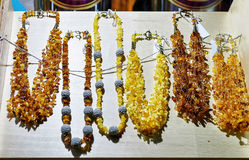 Amber accessories displayed for sale at the Riga Christmas market Royalty Free Stock Photo