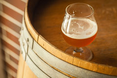 Amber ale on a barrel Royalty Free Stock Images