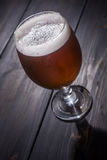 Amber ale on dark wood Royalty Free Stock Photography
